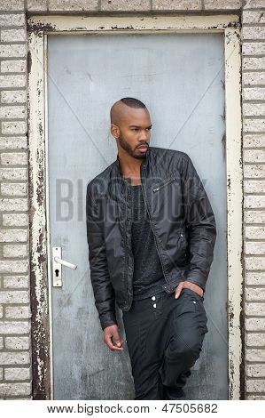 Attractive Young Black Man Standing In Door Way