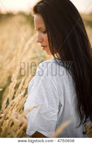 Beautiful Woman Outside In Field