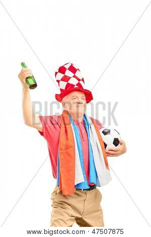 Mature male sport fan, with flag of Holland, holding a soccer ball and beer bottle isolated on white background