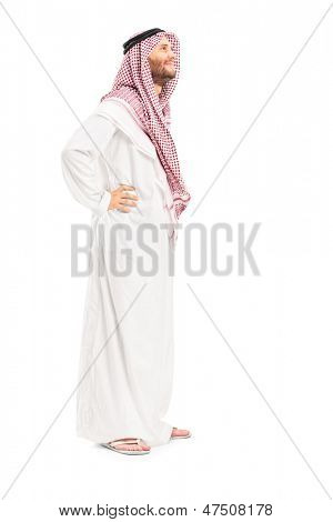 Full length portrait of a male arab person standing isolated on white background
