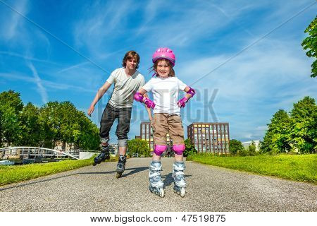Father and daughter enjoy roller skating