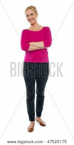 Full Length Portrait Of Happy Aged Woman Posing