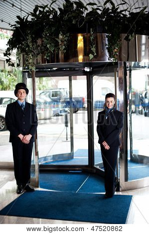 Door Man With Receptionist At The Entrance