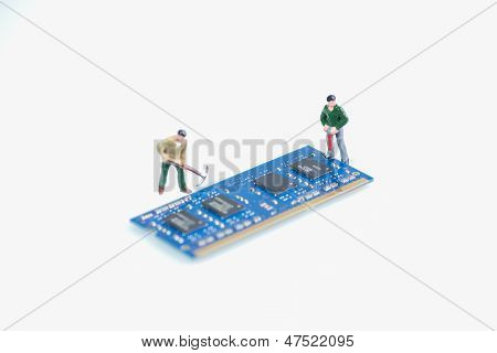 Miniature Workmen Working On RAM Component