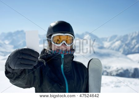 Attractive Girl With Ski Ticket