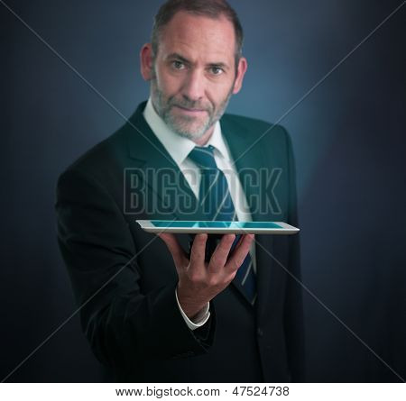 Smart Businessman Shows The Tablet Pc