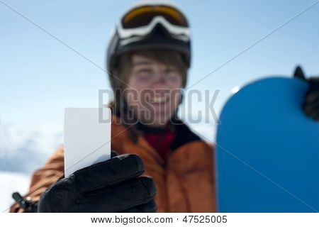 Man Holding Blank Skipass Smiling