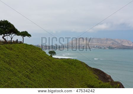Man Looking Over The Ocean From A Cliff At Miraflores In Lima, Peru