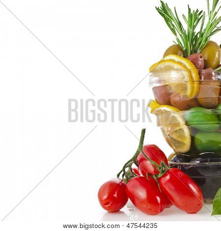 Border of tower olives dish with vegetables, herbs, spices  isolated on a white background