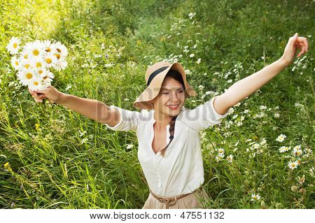 Happy Girl With A Bouquet Of Daisies