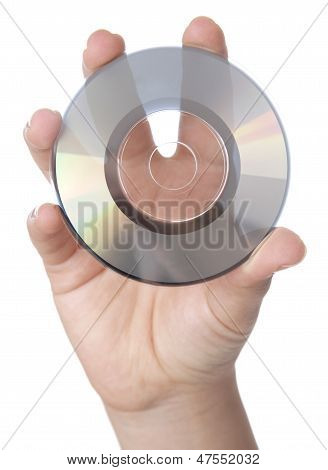 Hand Holding A Computer Disk Over White