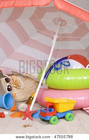 Beach Umbrella And Necessary Articles For Happy Holidays In Tropical Destination.