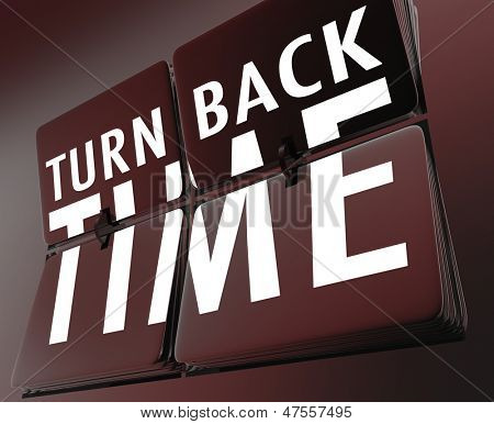 The words Turn Back Time on flipping tiles on a retro clock to illustrate going backward to the past to reverse a change