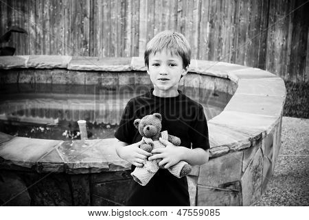 Little boy holding his stuffed animal.