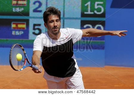 BARCELONA - APRIL, 23: Spanish tennis player Marc Lopez in action during his match against Tommy Robredo of Barcelona tennis tournament Conde de Godo on April 23, 2013 in Barcelona