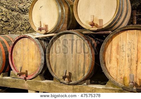 Wooden Wine Barrels In An Underground Cellar