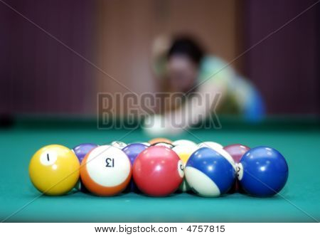 Billiard Balls And Blurred Woman In The Background