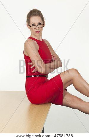 Provocative Secretary Posing Sitting On The Desk
