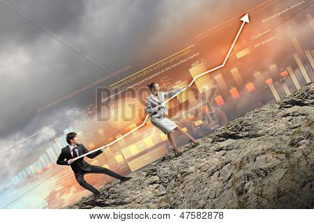 Image of young businesspeople pulling graph. Chart growth concept