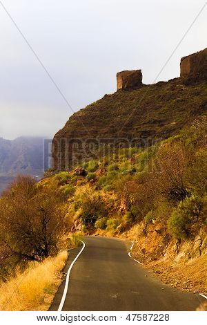 Narrow mountain road in evening light