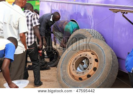 Changing A Bus Tire And Brakes In Africa