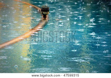 Surface Of An Artesian Well On A Rainy Day