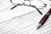 stock photo of medicare  - Medicare insurance form with glasses and pen - JPG