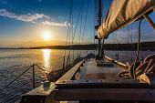 stock photo of sails  - sunset at sea on aboard the Yacht Sailing - JPG