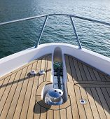 stock photo of pontoon boat  - The frontal view of a luxurious and expensive yacht - JPG