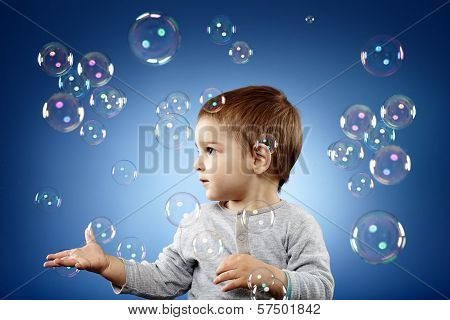 Toddler Trying To Catch Bubbles