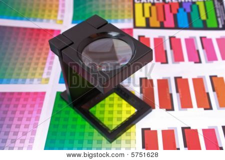 Magnifying Glass On Color Guide And Swatch. Color Selection Pre-press Concept