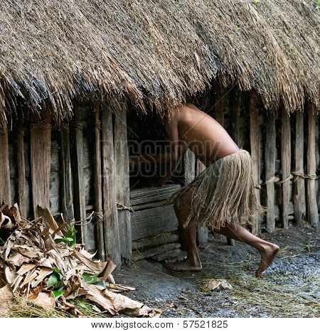The Woman In A Traditional Skirt Hides In A Hut.
