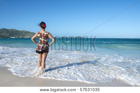 Woman Wearing Floral Dress Standing in the Sea