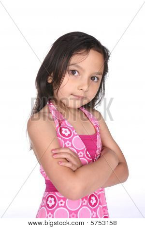 Cute Girl With Arms Crossed And A Stubborn Look On Her Face