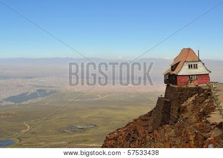 House Sitting High On The Edge Of Rocky Cliffs