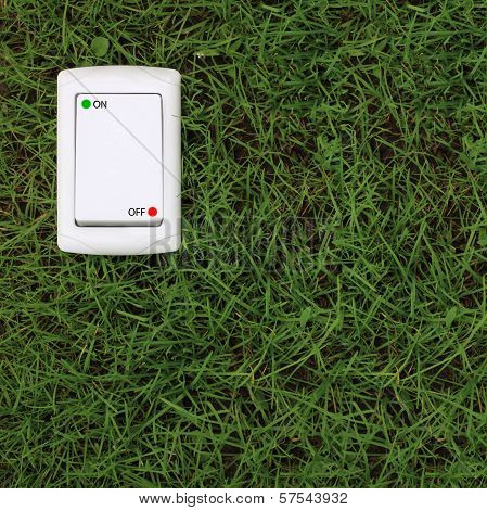 Electric Power Switch On A Green Grass Background