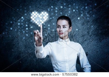 Woman Pointing at Glowing Digital Heart