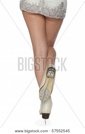 Woman In Skates Standing On Ice