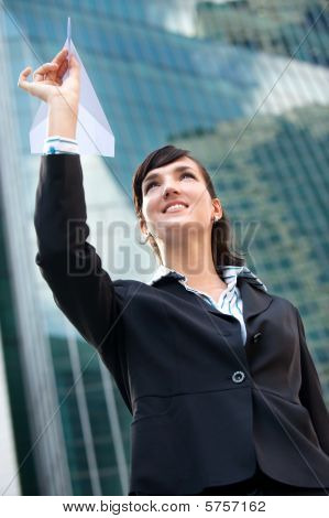 Businesswoman With Paper Plane