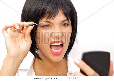 Beautiful Woman Tweezing Her Eyebrows With Tweezers