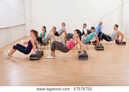 Large Group Of People Working Out Together