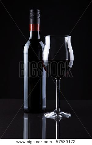 Bottle Of Wine And Glass Isolated On Black Background