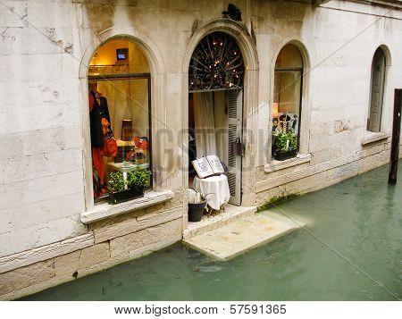 VENICE, VENETO, ITALY - MAY, 20th 2008: - shop in flooded street