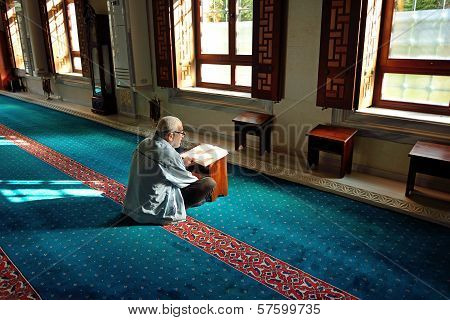 Muslims Read The Qur'an In The Mosque Alone