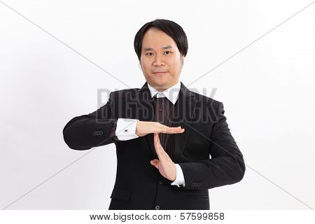 Isolated Portrait Of Business Man Showing A Time Out