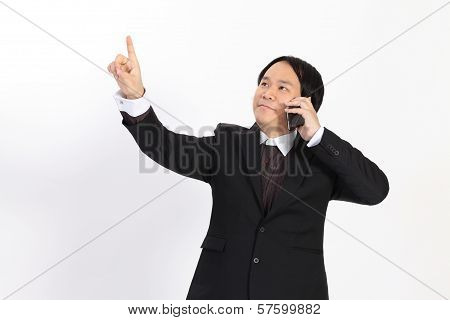 Isolated Business Man Call Mobilephone And Writing Whatever You Want With Him Finger