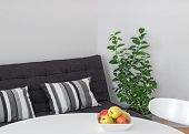 picture of futon  - Room with round table sofa and green lemon tree - JPG