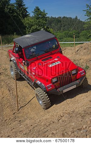 Red Offroad Car On The Trial Race