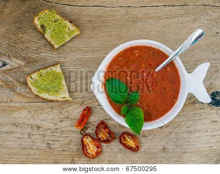 A Bawl Of Tomato Soup On A Wooden Desk