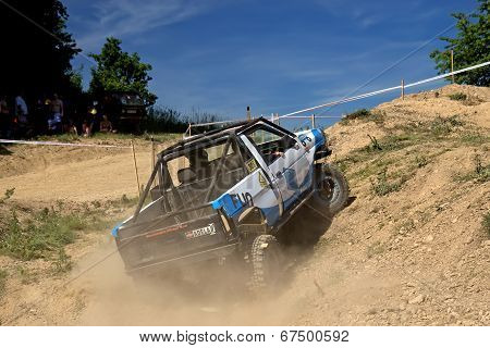 Off-road Car Is Hitting A Steep Hill